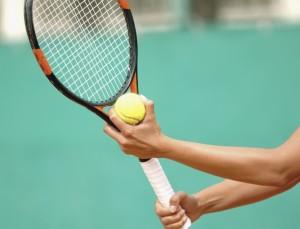Tennis Player Preparing to Serve --- Image by © Royalty-Free/Corbis